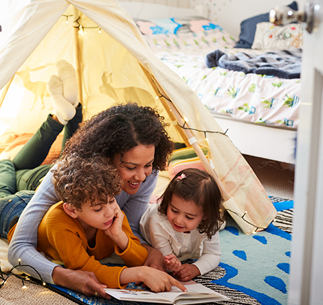 mom reading with kids in tent