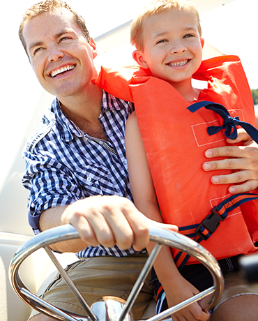 Dad and child on boat