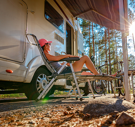 person relaxing by RV
