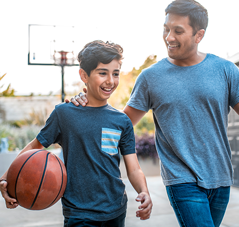 Fatehr and Son playing basketball