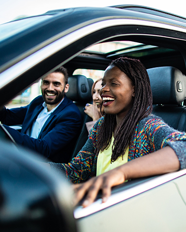 An African American woman driving a car with a man in the passenger seat