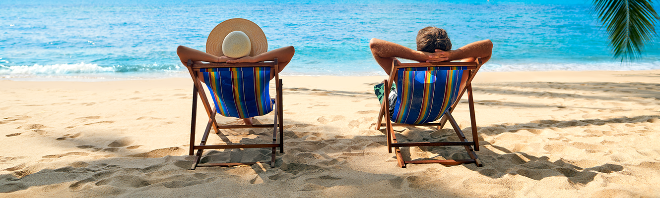two people at beach in chairs